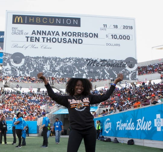 FAMU pharmacy major Annaya Morrison receives $10,000 scholarship from McDonald's at the Florida Classic in Orlando.