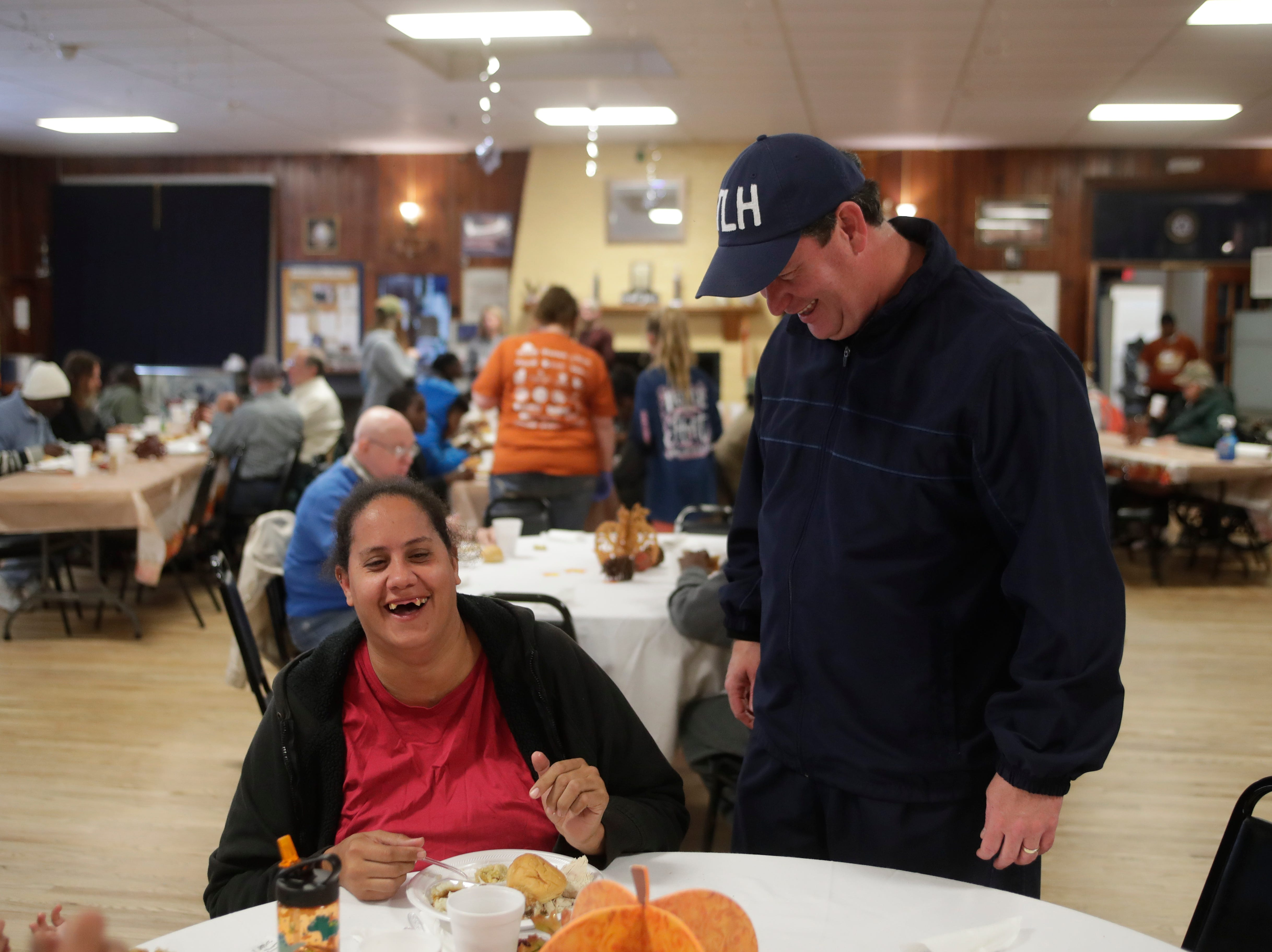 Mayor John Dailey wishes Michele Carmon a happy birthday as she enjoys her Thanksgiving meal during the Annual Community Thanksgiving Celebration at the American Legion Post 13 on Lake Ella Drive in Tallahassee, Fla. Thursday, Nov. 22, 2018.