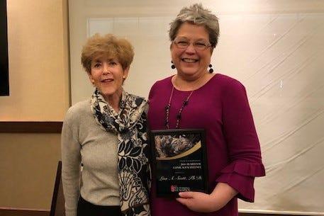 FSU researcher Lisa Scott, right, presented the awarded by The Stuttering Foundation President Jane Frasher.