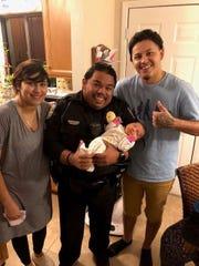 Parents Stephania Quivoga and Alex A. Rocha-Cerda rejoice after Fort Pierce police officer Jorge Goz saved their infant, Alybree-Dejeus Cerda.