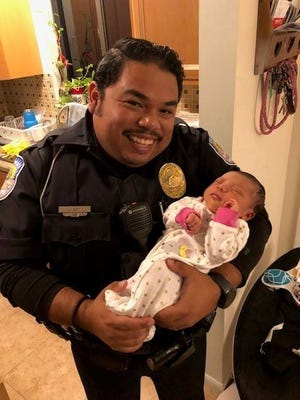 Fort Pierce police officer Jorge Goz helped save a choking 6-day-old baby the week before Thanksgiving.