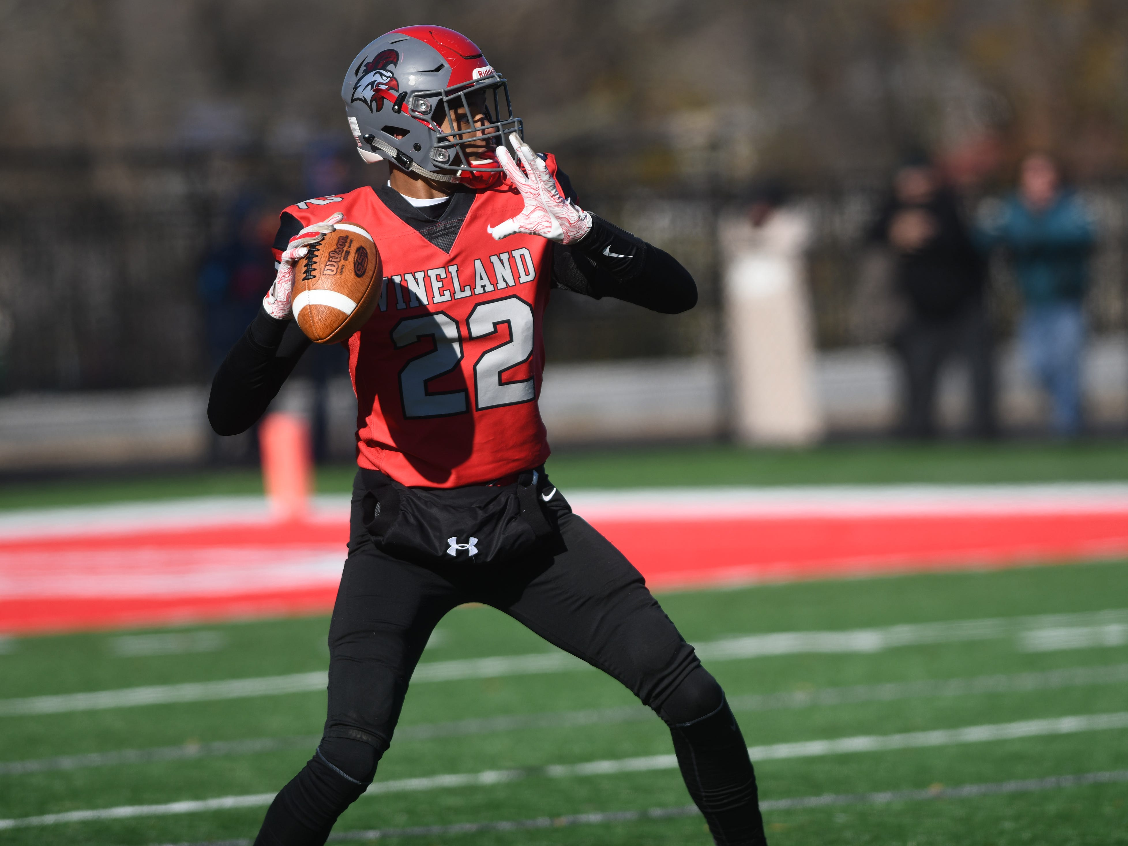 Vineland QB, Tyreem Powell, looks for a open receiver against Millville at Gittone Stadium on Thanksgiving Day. The Fighting Clan topped the Thunderbolts, 26-6 on Thursday, November 22, 2018.