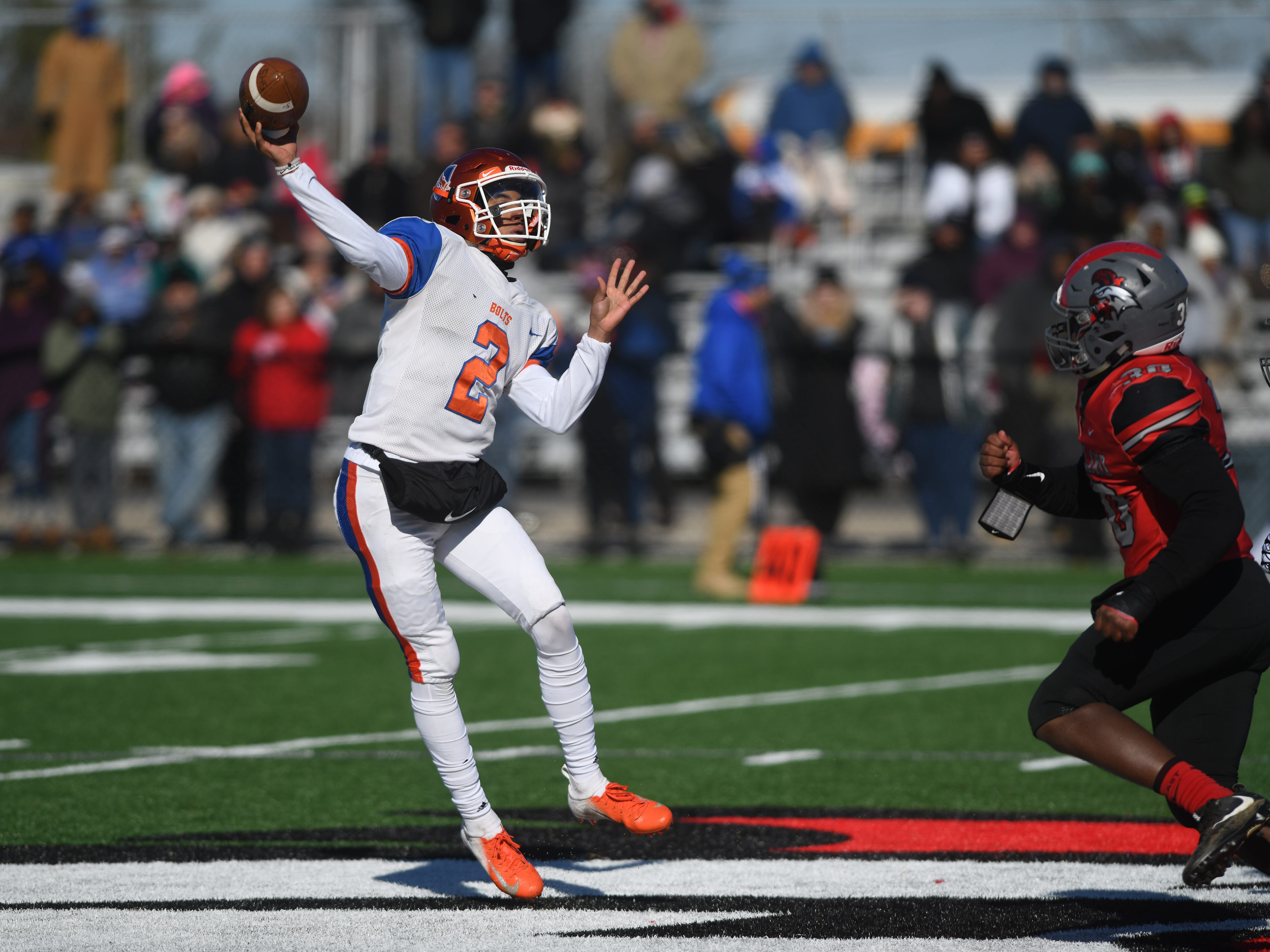 Millville's QB Eddie Jamison throws downfield against Vineland at Gittone Stadium on Thanksgiving Day. The Fighting Clan topped the Thunderbolts, 26-6 on Thursday, November 22, 2018.