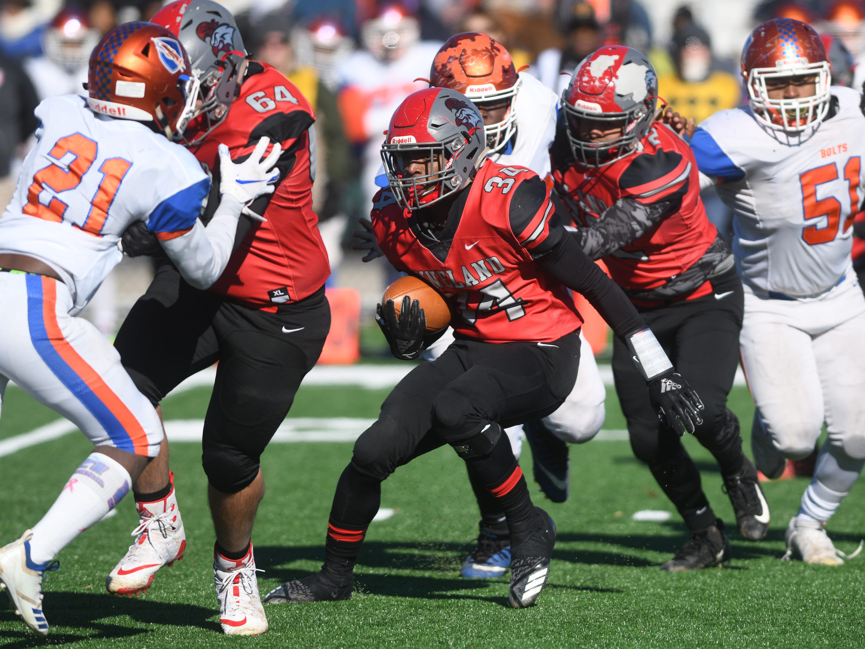 Vineland's Nahzir Broome runs for a gain against visiting Millville on Thanksgiving Day. The Fighting Clan topped the Thunderbolts, 26-6.