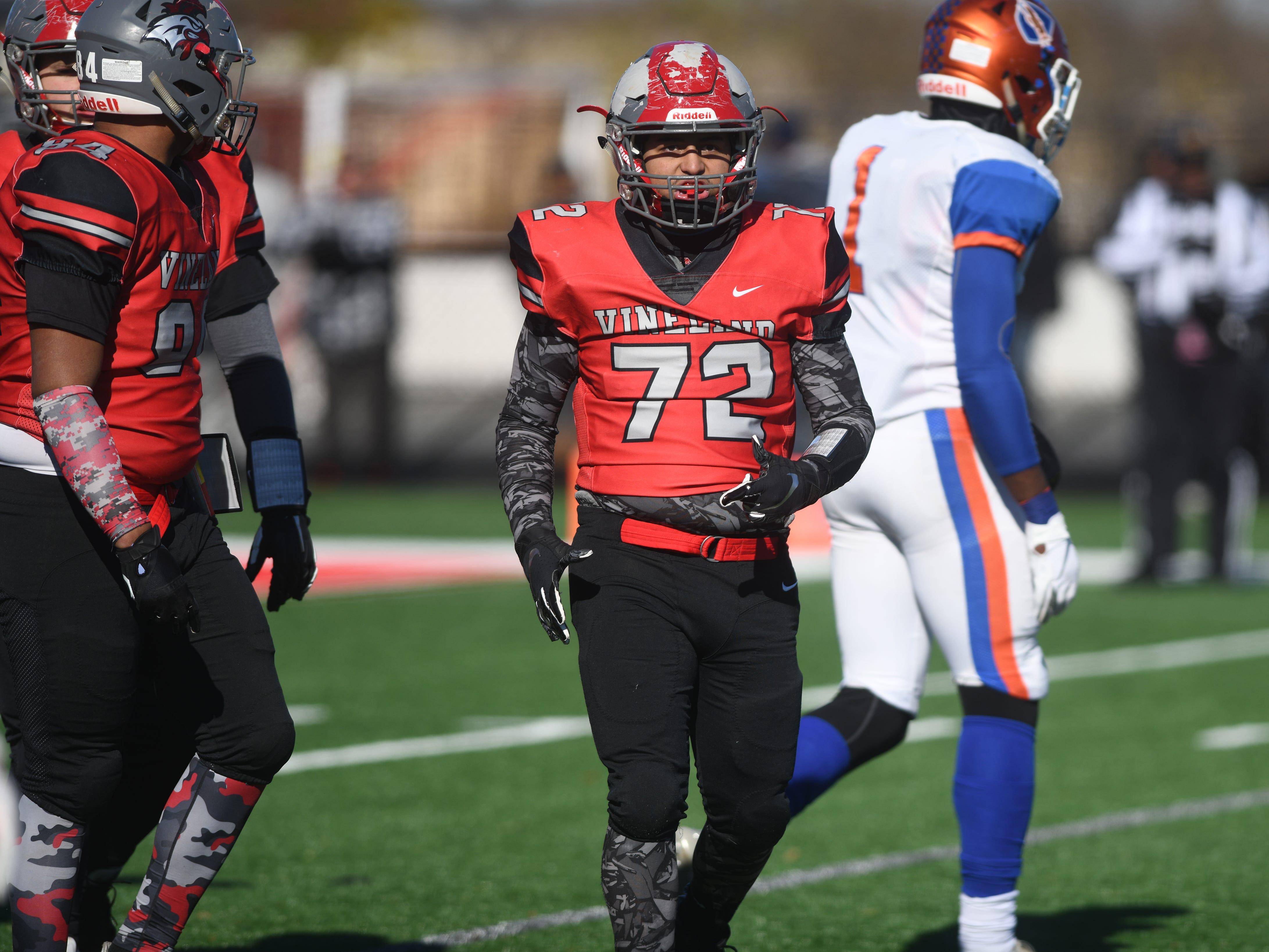 Vineland's Daniel Medina checks the sideline during a game against Millville at Gittone Stadium on Thanksgiving Day.