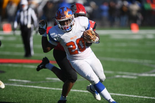 Millville's Aahznier Hayes runs for a short gain against Vineland at Gittone Stadium on Thanksgiving Day. The Fighting Clan topped the Thunderbolts, 26-6 on Thursday, November 22, 2018.