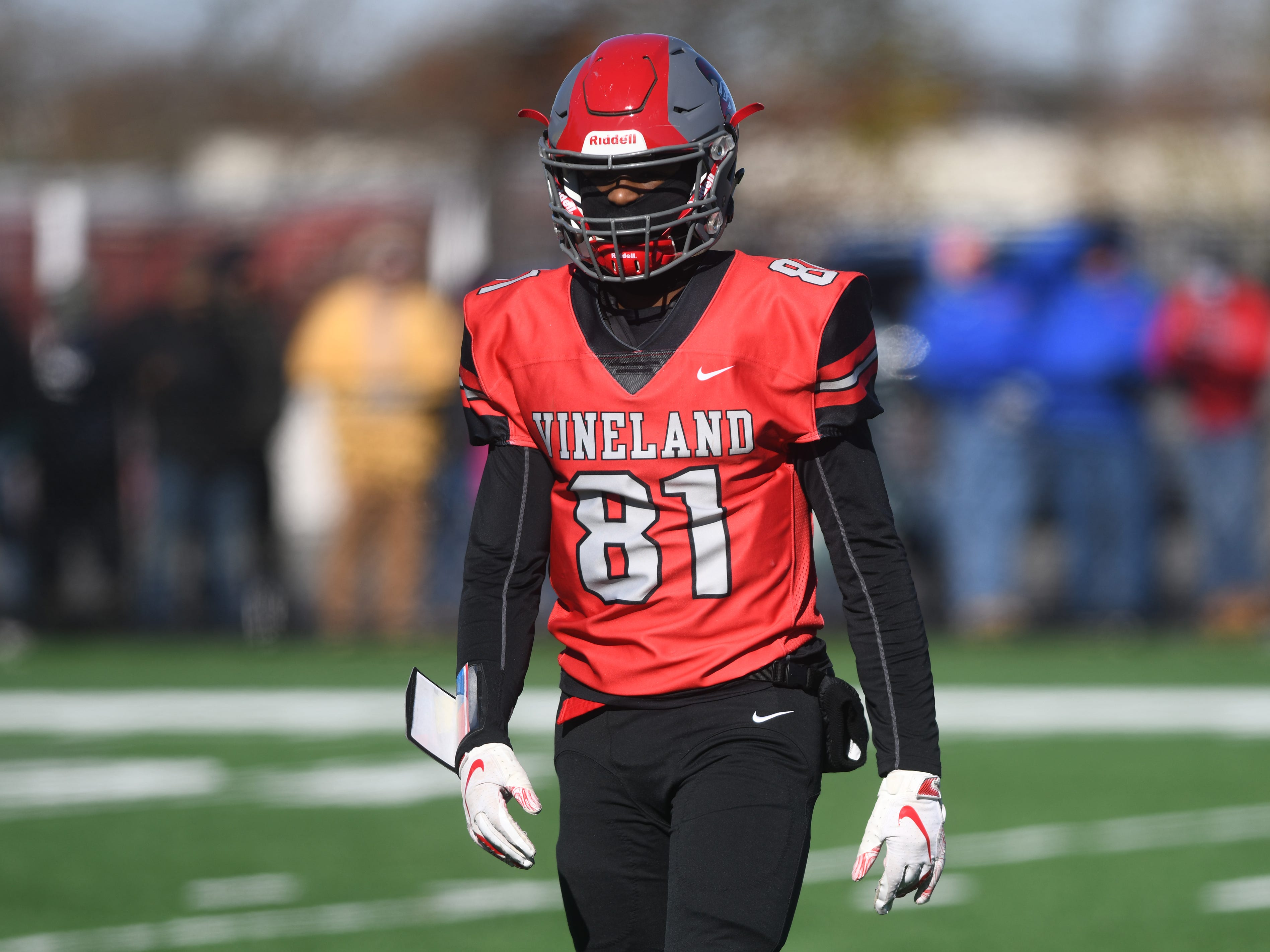 Vineland's Conrad Jackson III checks the sideline during a game against Millville at Gittone Stadium on Thanksgiving Day.