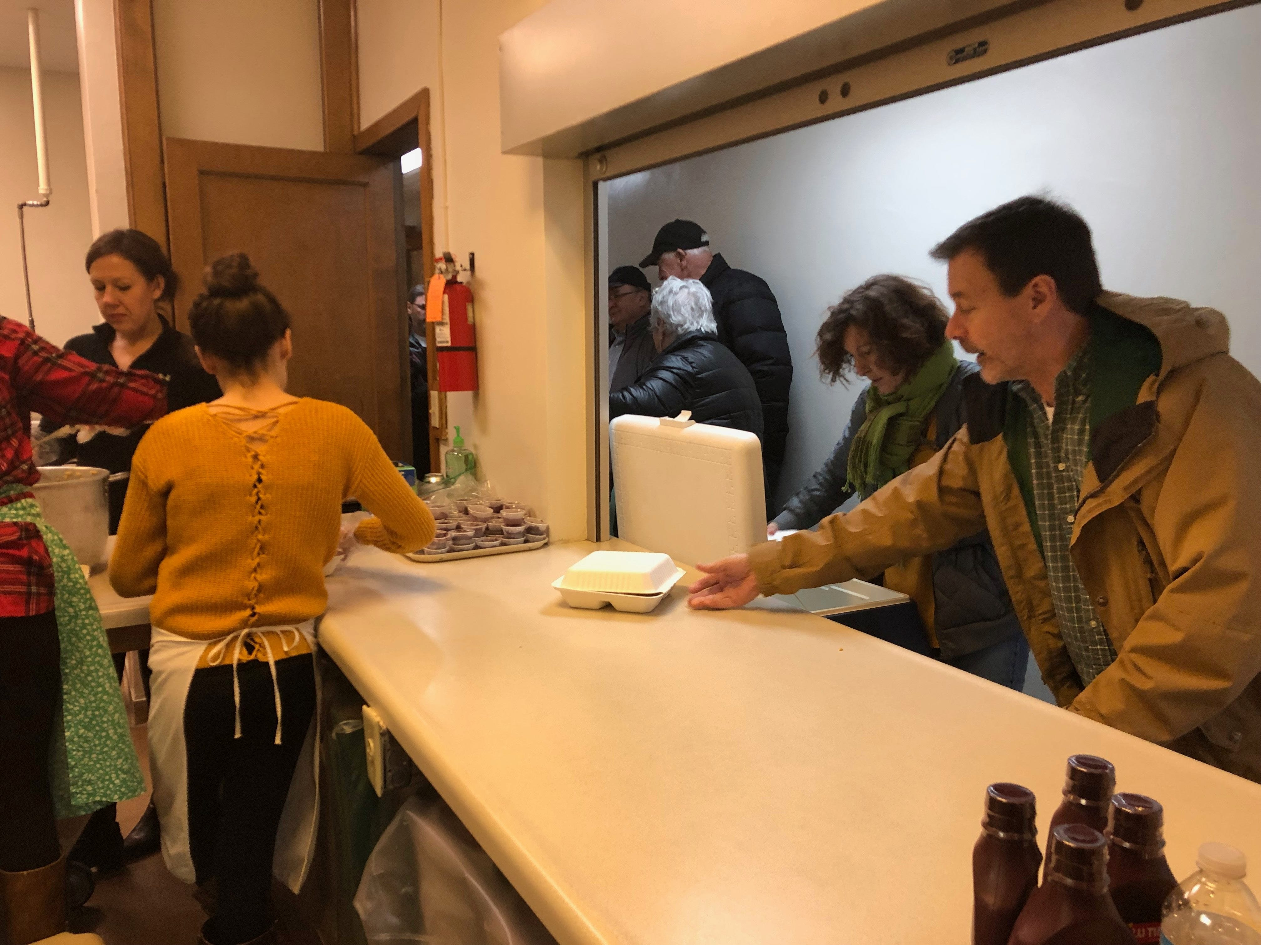 Voluteers load up Thanksgiving dinners to be delivered to people in the Wausau area at the First Presbyterian Church on Nov. 22.