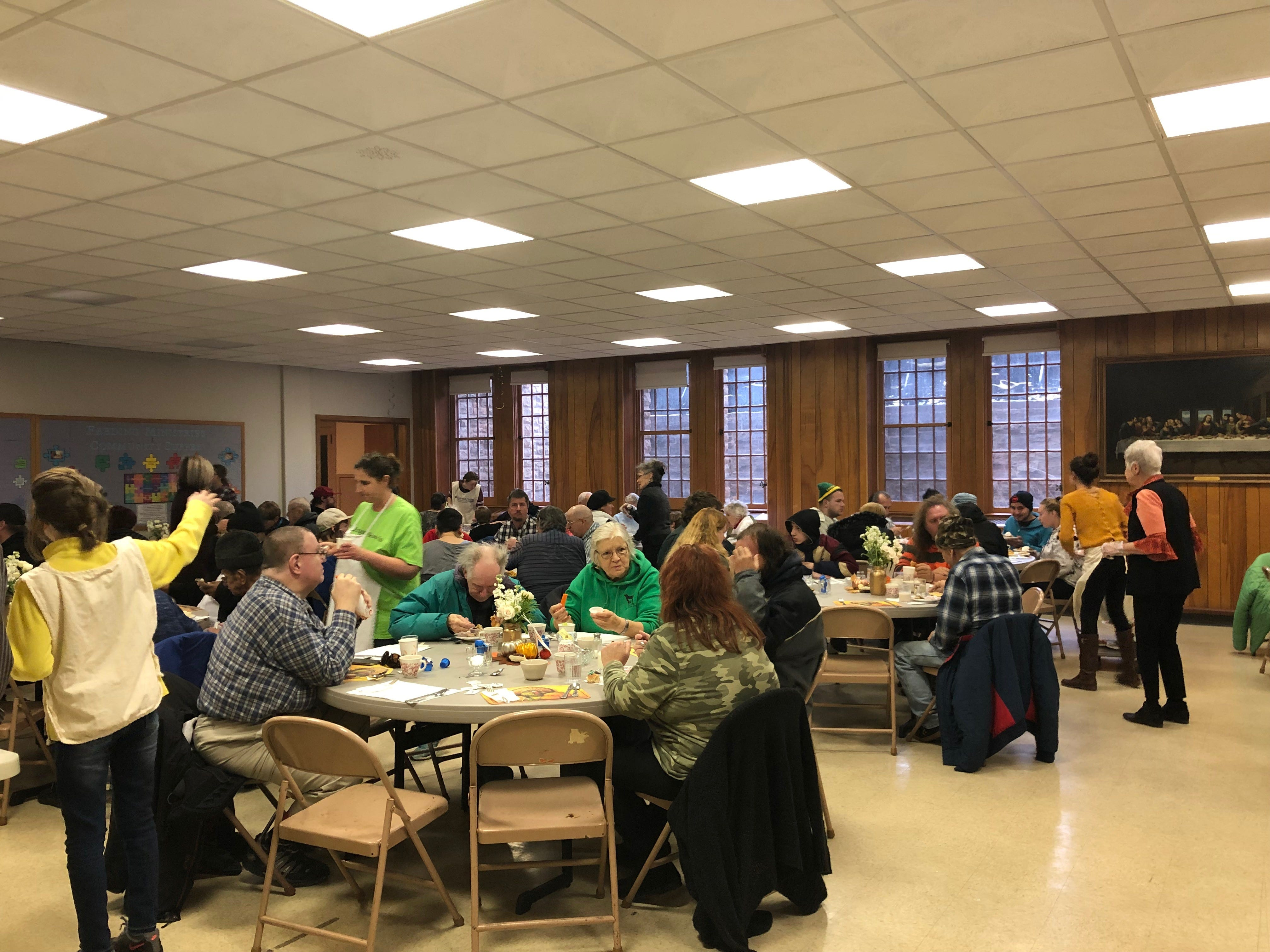 Community members chat over a turkey dinner at First Presbyterian Church on Nov. 22.