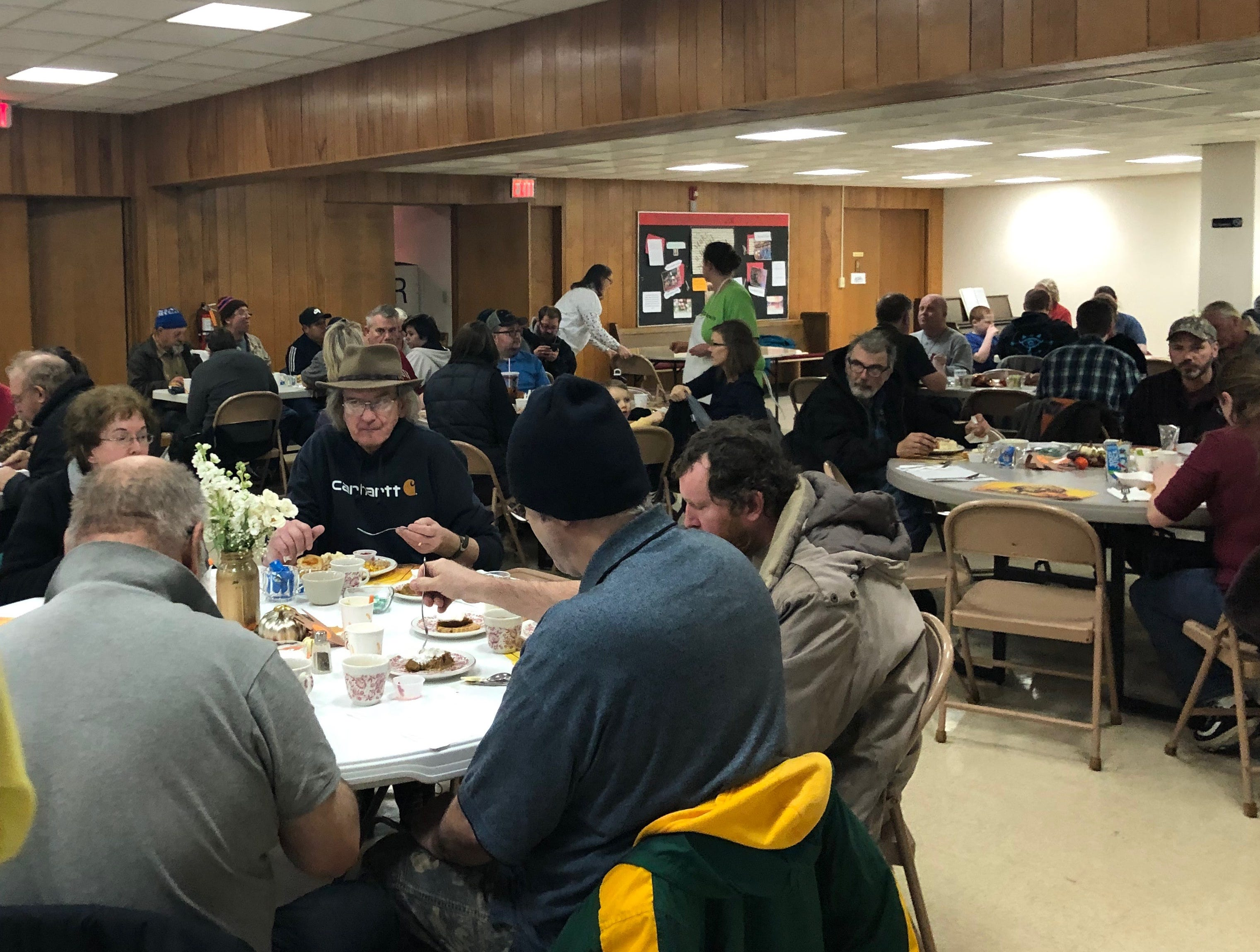Community members dig into a Thanksgiving dinner at First Presbyterian Church on Nov. 22.
