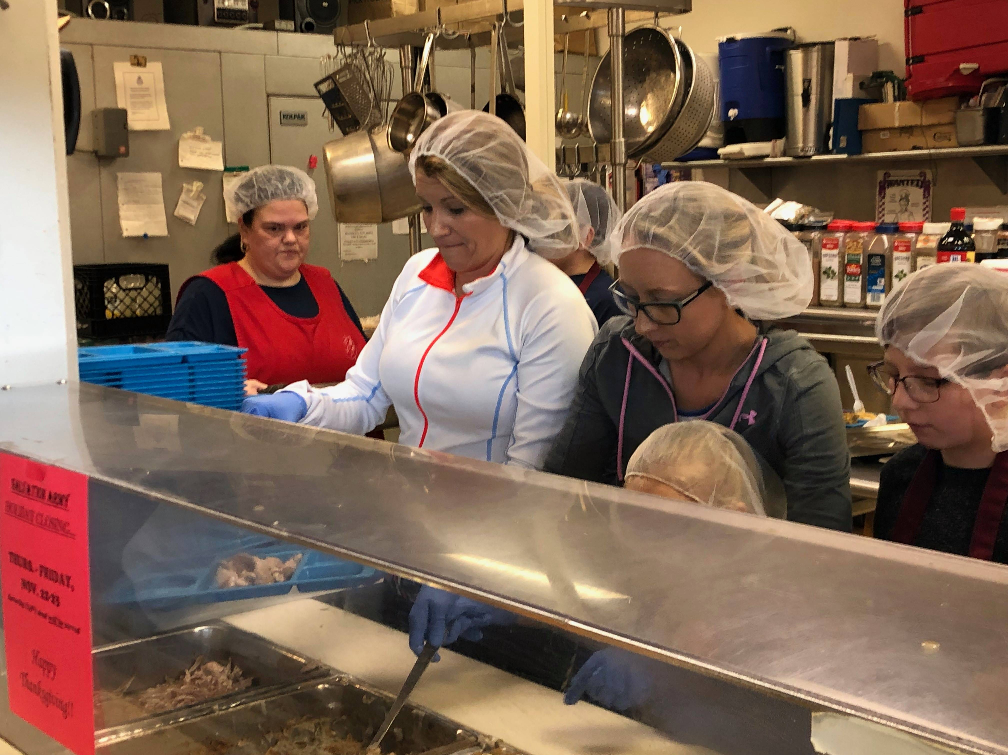 Volunteers at the Salvation Army serve up Thanksgiving food on Nov. 21 in Wausau.