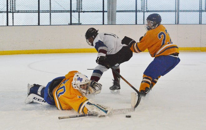 Mahopac goalie Logan MacDougall pokes the puck away, stopping a breakaway attempt by Rye Town/Harrison forward Jack Shapiro during a 7-2 by the Indians on Wednesday, Nov. 21, 2018 at Ebersole Ice Rink. MacDougall stopped 26 shots.
