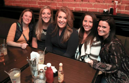 Patrons hit Scratch Magoo's during Thanksgiving-Eve revelry in Wilmington.