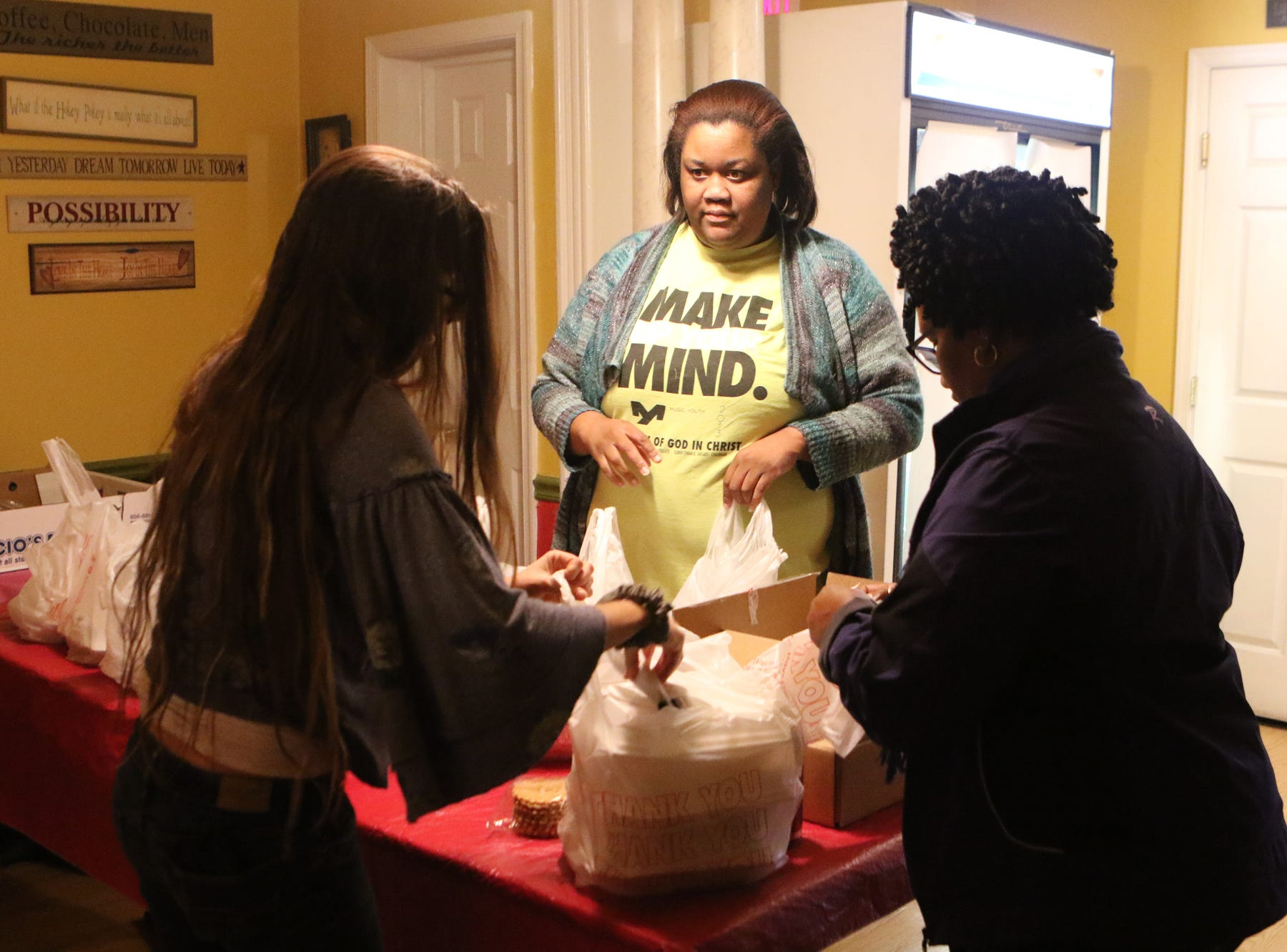 Volunteers at Simaron Pizza & Steak Shop in Dover bag turkey dinners to deliver to people in the Dover community Thursday. The owners, employees and their children helped serve Thanksgiving dinner to those who couldn't afford dinner or who were alone on the holiday.