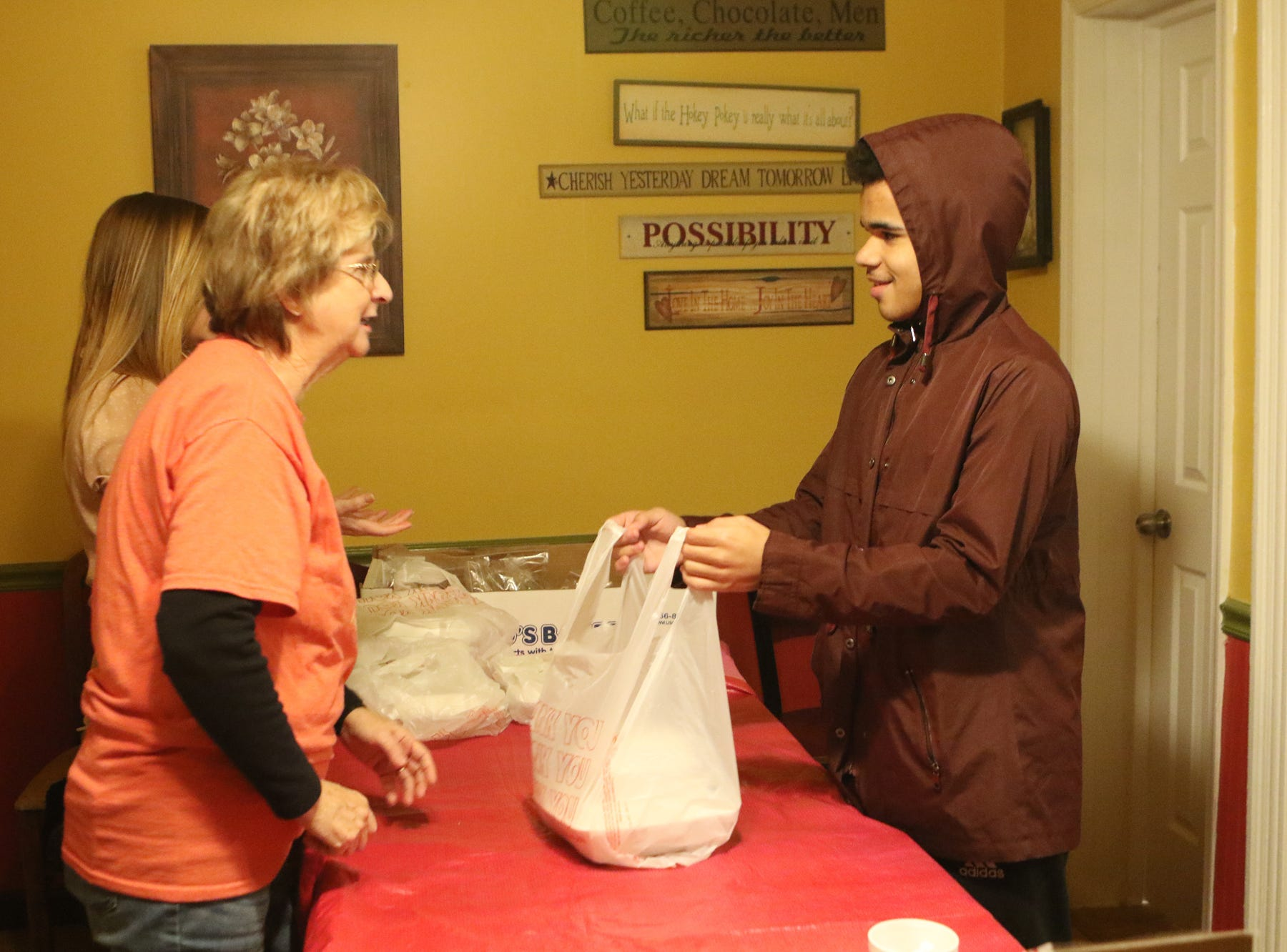 The owners, employees and their children at Simaron Pizza & Steak Shop in Dover opened up the restaurant on Thanksgiving Day to feed those who couldn't afford dinner or who were alone on the holiday.