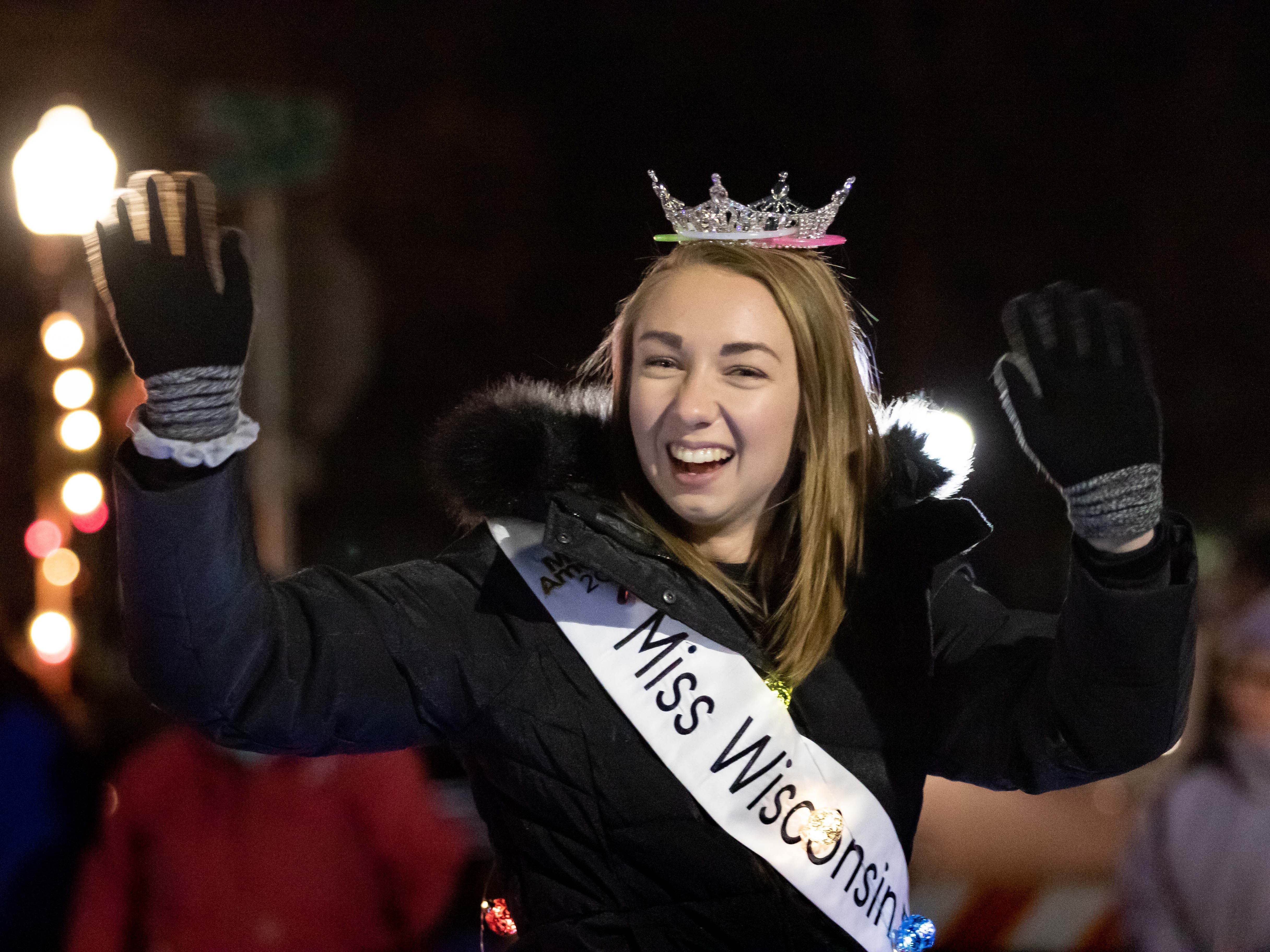 Miss Wisconsin Rapids Area 2019 Danielle Moon waves to the crowd gathered for the Rekindle the Spirit holiday parade on Wednesday, Nov. 21, 2018, in downtown Wisconsin Rapids.