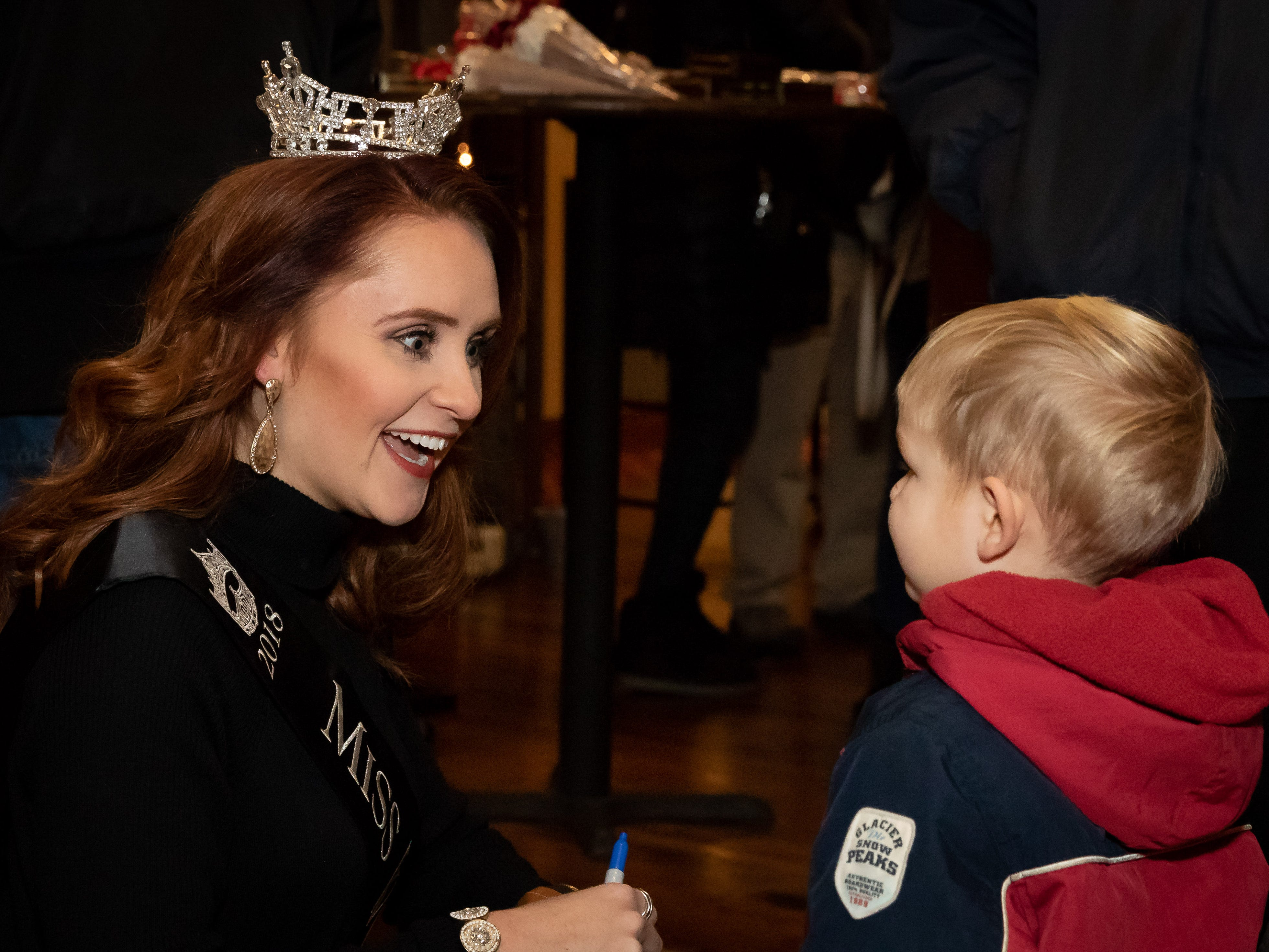 Miss Wisconsin 2018 Tianna Vanderhei talks with a young boy following the Rekindle the Season holiday parade on Wednesday, Nov. 21, 2018, in downtown Wisconsin Rapids.