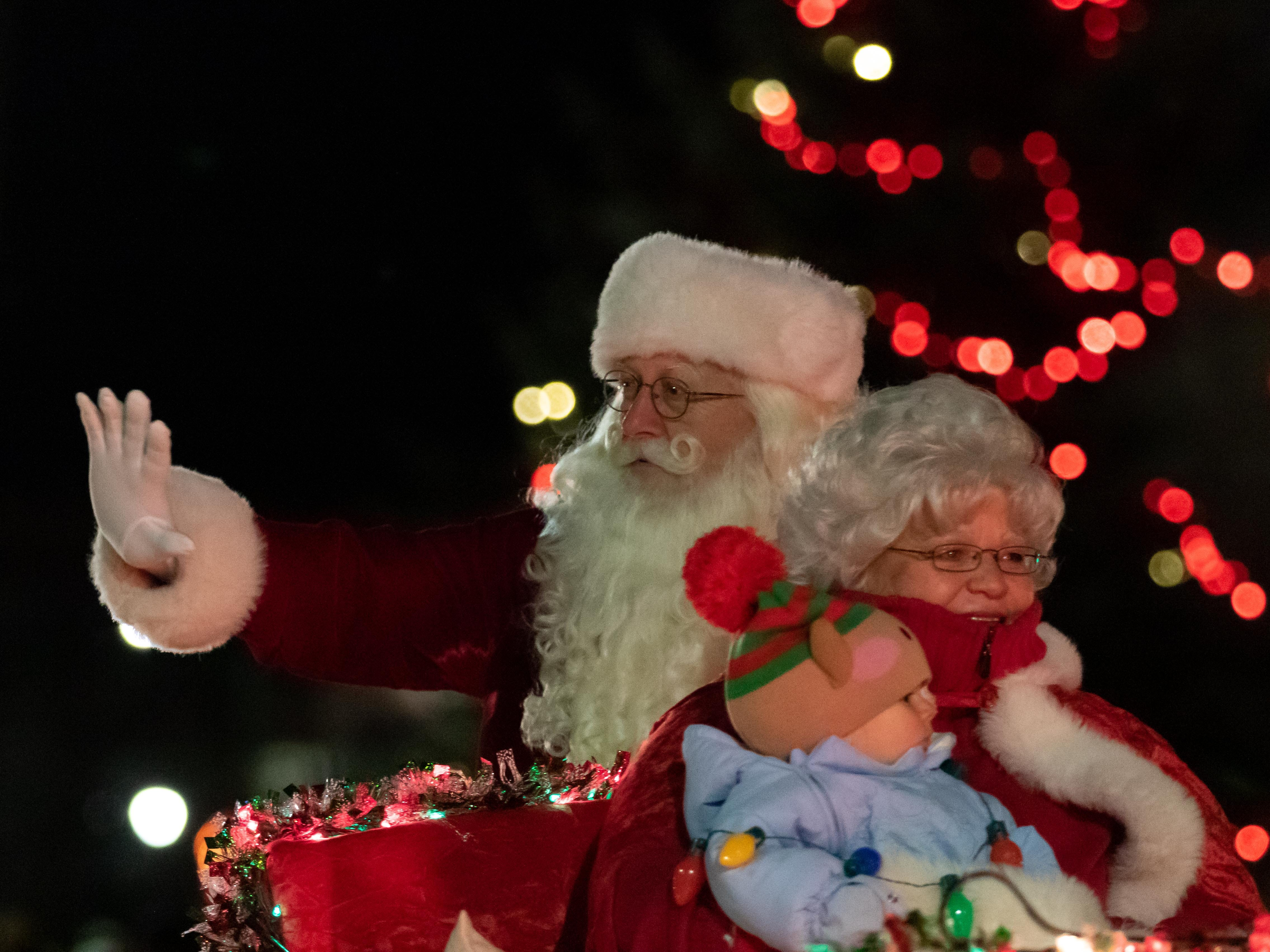 Santa and Mrs. Claus wave to the crowd gathered for the Rekindle the Spirit holiday parade on Wednesday, Nov. 21, 2018, in downtown Wisconsin Rapids.