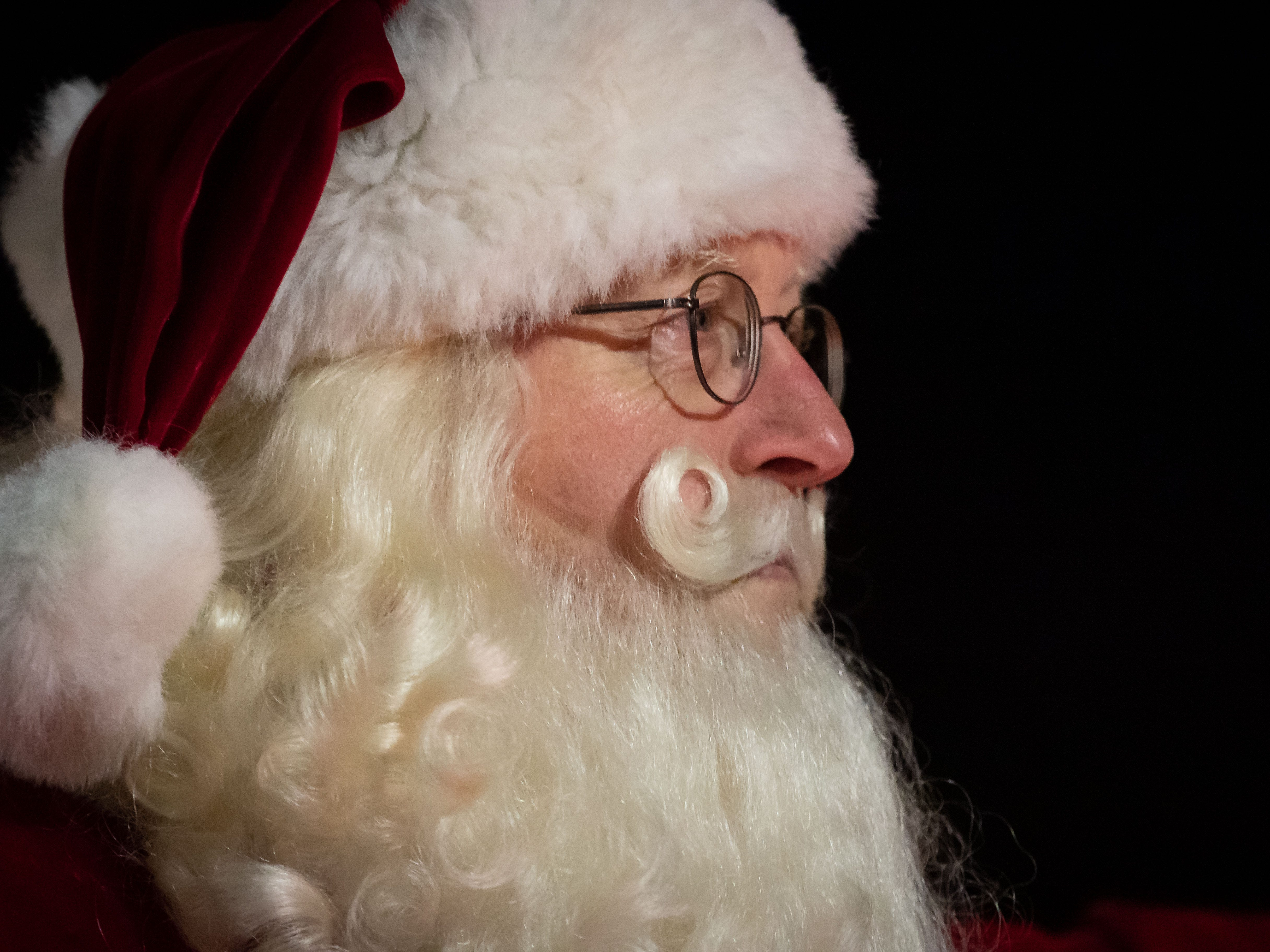Santa Claus looks out at the crowd gathered for the Rekindle the Spirit holiday parade on Wednesday, Nov. 21, 2018, in downtown Wisconsin Rapids.