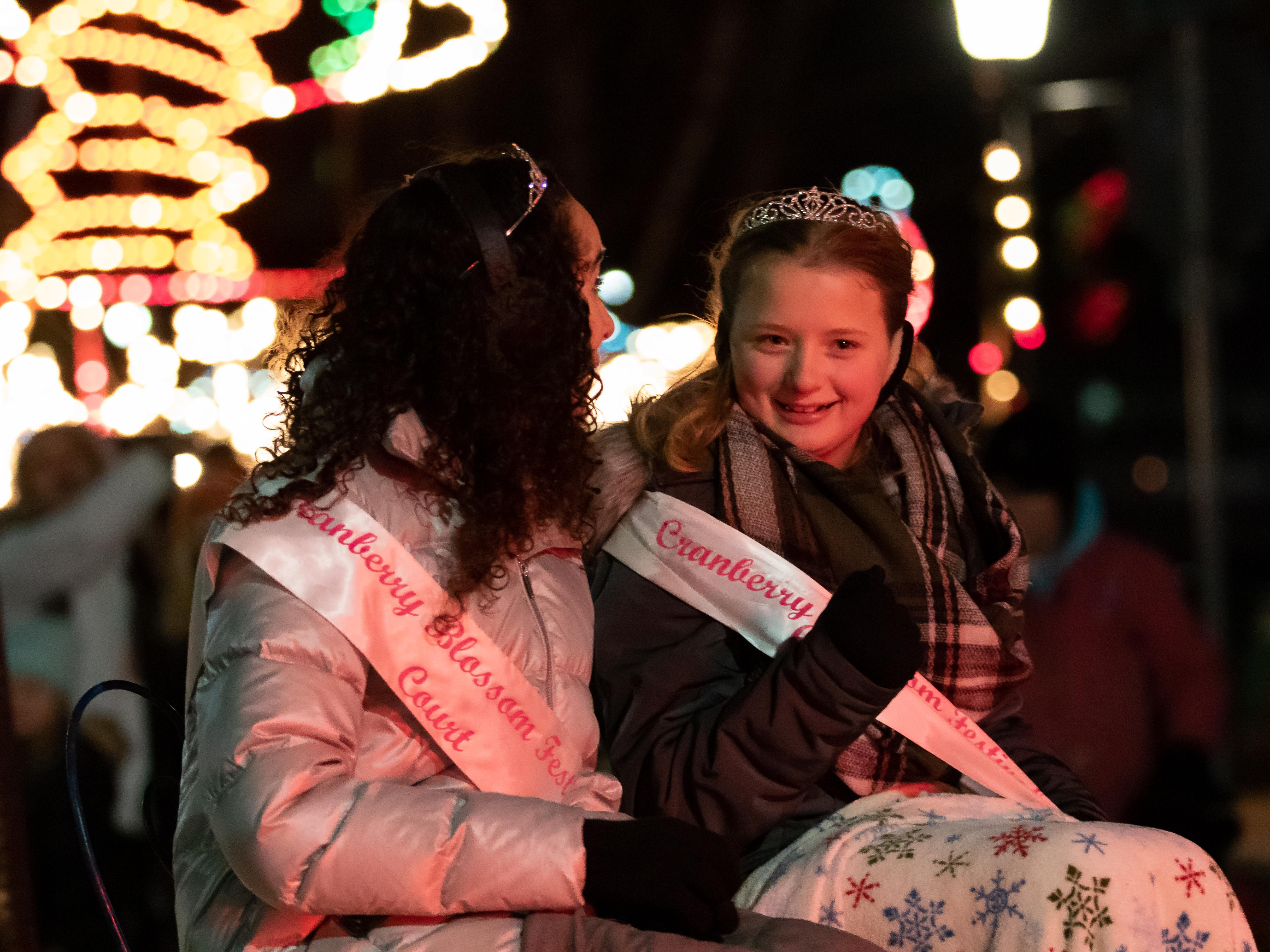 Members of the Cranberry Blossom Festival Court participate in the Rekindle the Spirit parade on Wednesday, Nov. 21, 2018, in downtown Wisconsin Rapids.