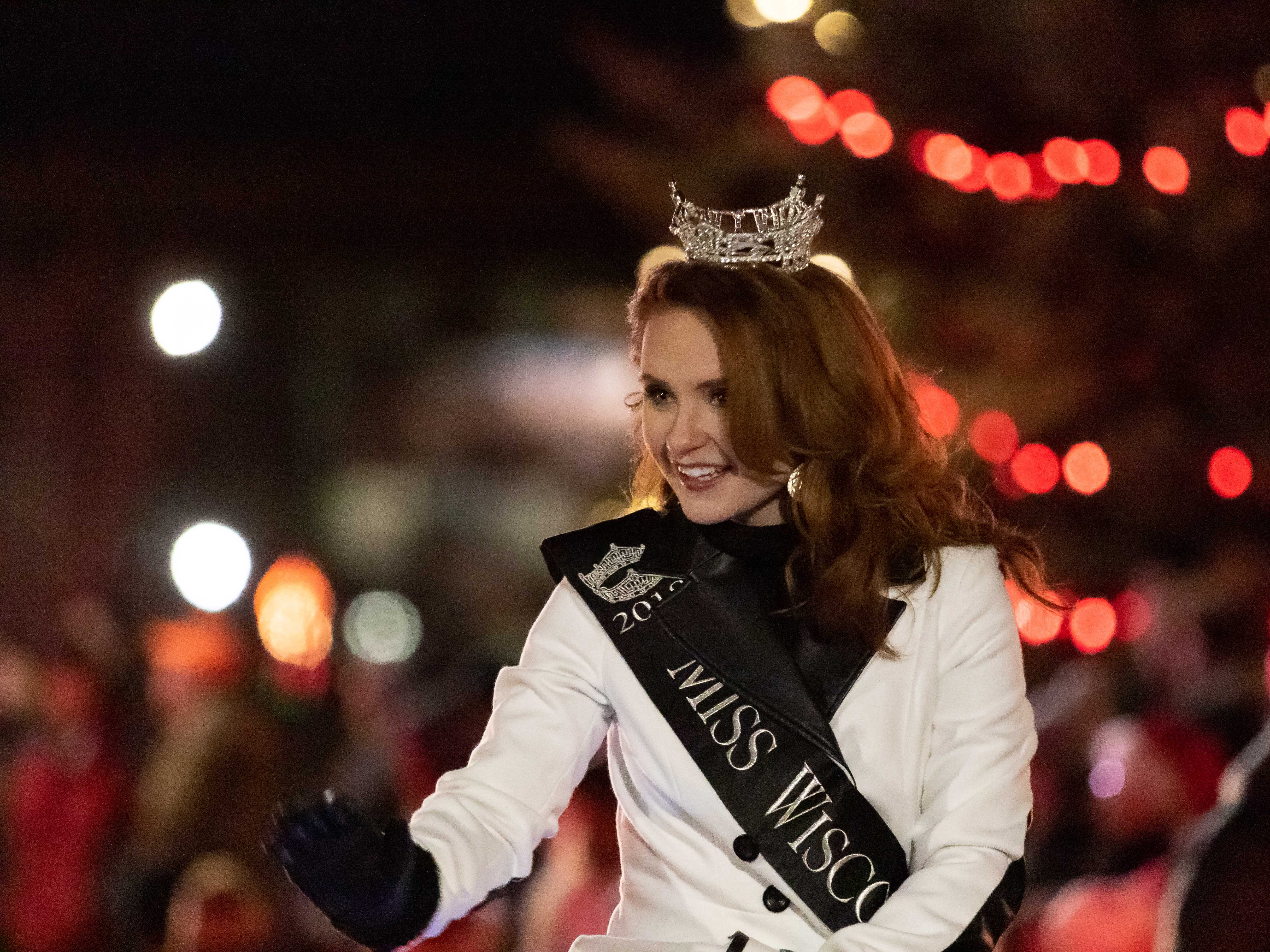 Miss Wisconsin 2018 Tianna Vanderhei waves to the crowd gathered for the Rekindle the Spirit holiday parade on Wednesday, Nov. 21, 2018, in downtown Wisconsin Rapids.