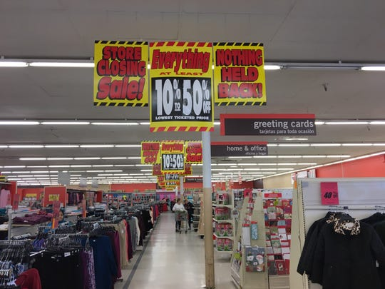 Shoppers looked for bargains at the Kmart in Springfield, Virginia, on Thanksgiving morning. It's one of 142 Sears and Kmart locations parent company Sears Holdings said would close when it filed for Chapter 11 bankruptcy protection last month.