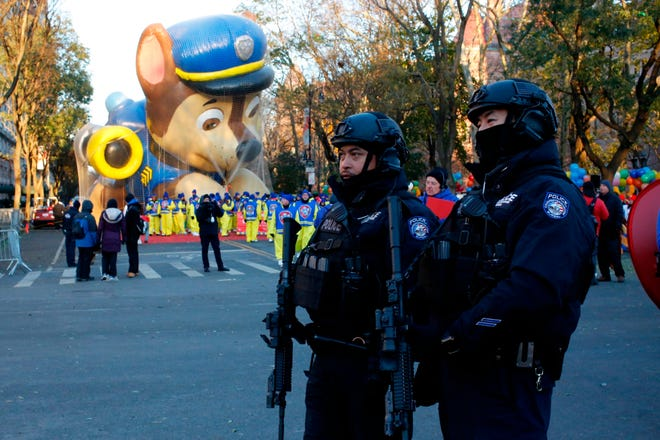 Members of the New York Police Department take a position along the route before the start of the 92nd annual Macy's Thanksgiving Day Parade in New York, on Nov. 22, 2018.