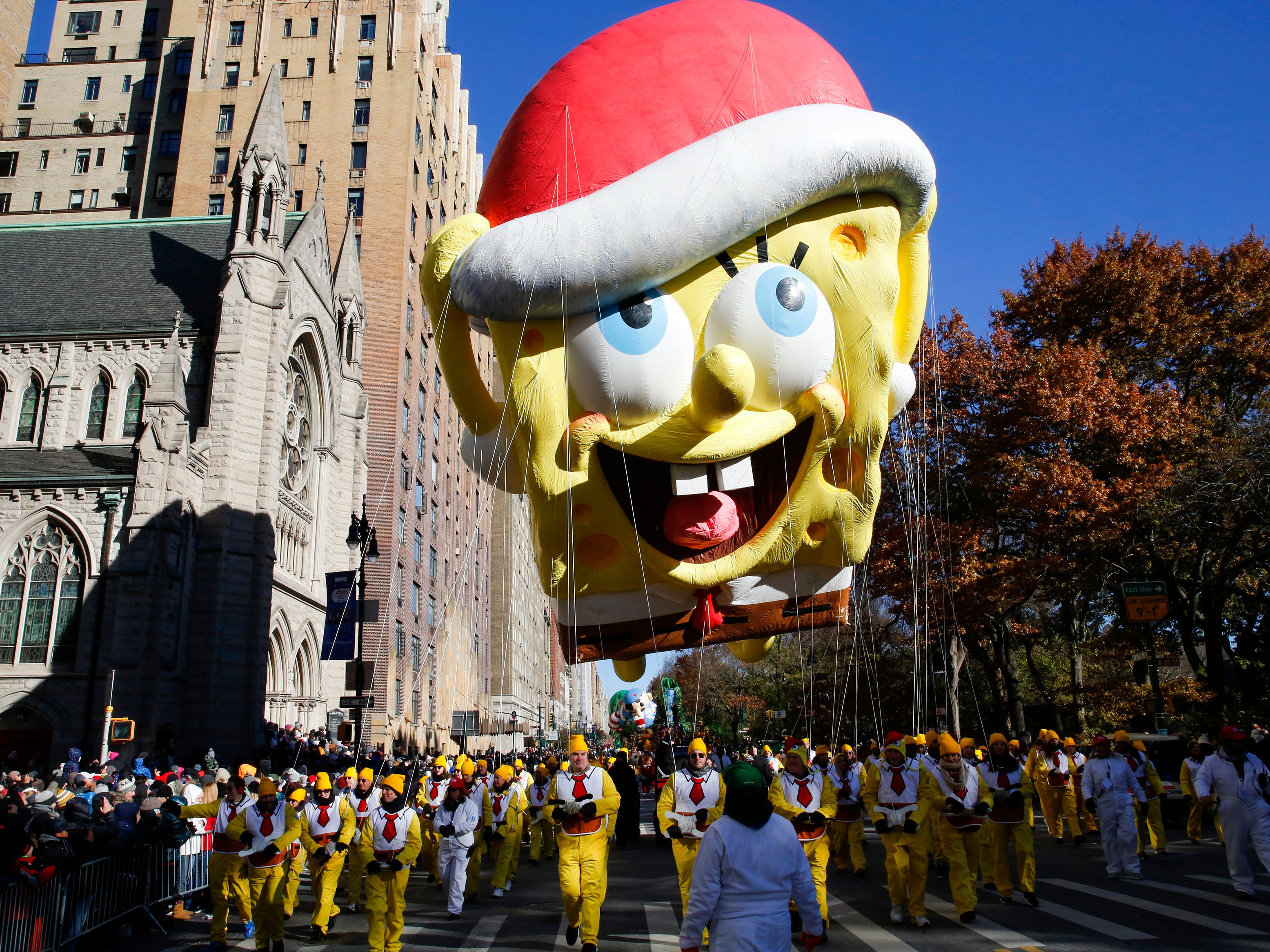 A Spongebob Squarepants balloon floats over Central Park West during the 92nd annual Macy's Thanksgiving Day Parade in New York, Thursday, Nov. 22, 2018.