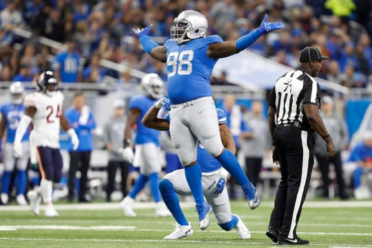 Lions defensive tackle Damon Harrison (98) celebrates after a play.