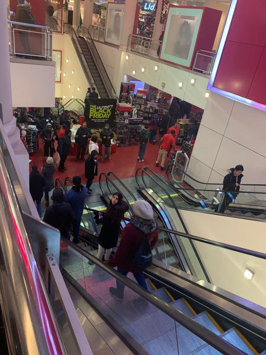 Shoppers looked for deals at the Manhattan Mall in New York City on Thanksgiving.