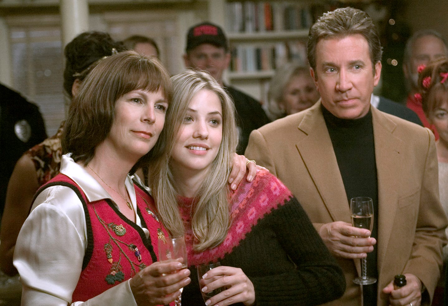 "Jamie Lee Curtis, left, Julie Gonzalo and Tim Allen in a scene from the motion picture ""Christmas with the Kranks."""
