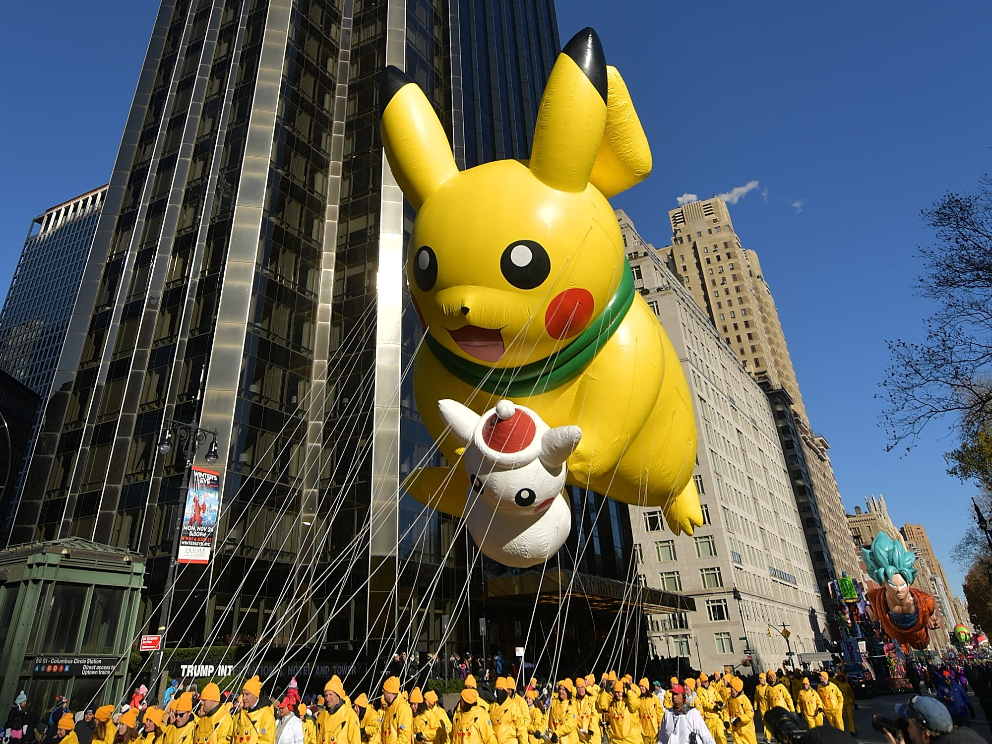 The Pikachu and Snowman Pikachu balloons float along the parade route during the 2018 Macy's Thanksgiving Day Parade, Nov. 22, 2018, in New York.