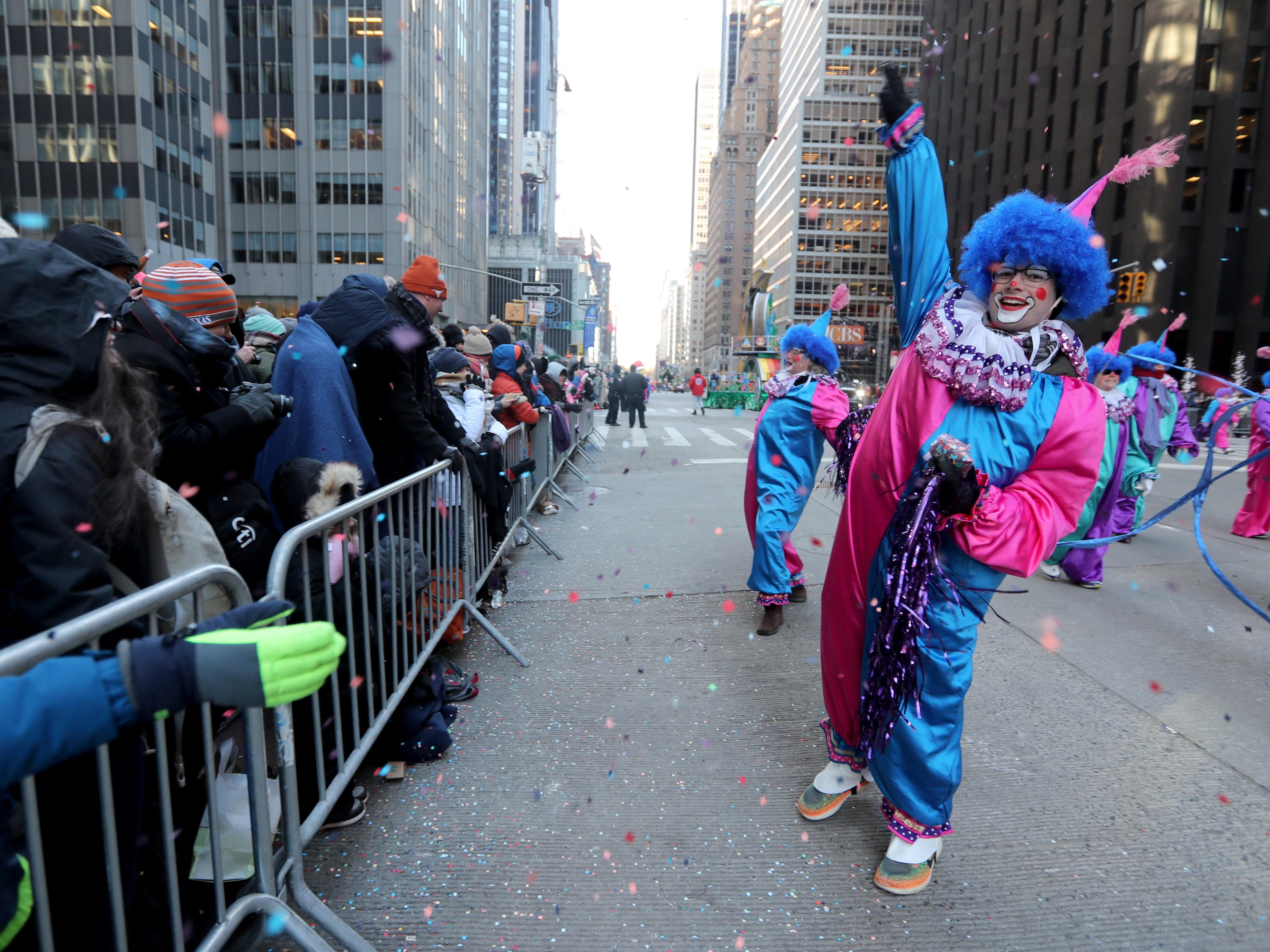 Clowns entertain spectators along 6th Ave. in New York during the annual Macy's Thanksgiving Day Parade, Nov. 22, 2018.