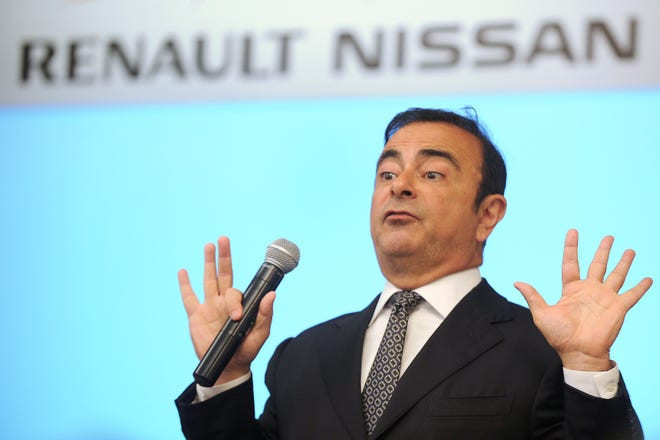 In this file photo taken on July 16, 2013, Chairman and CEO of Renault-Nissan Carlos Ghosn gestures while addressing a press conference in Chennai.