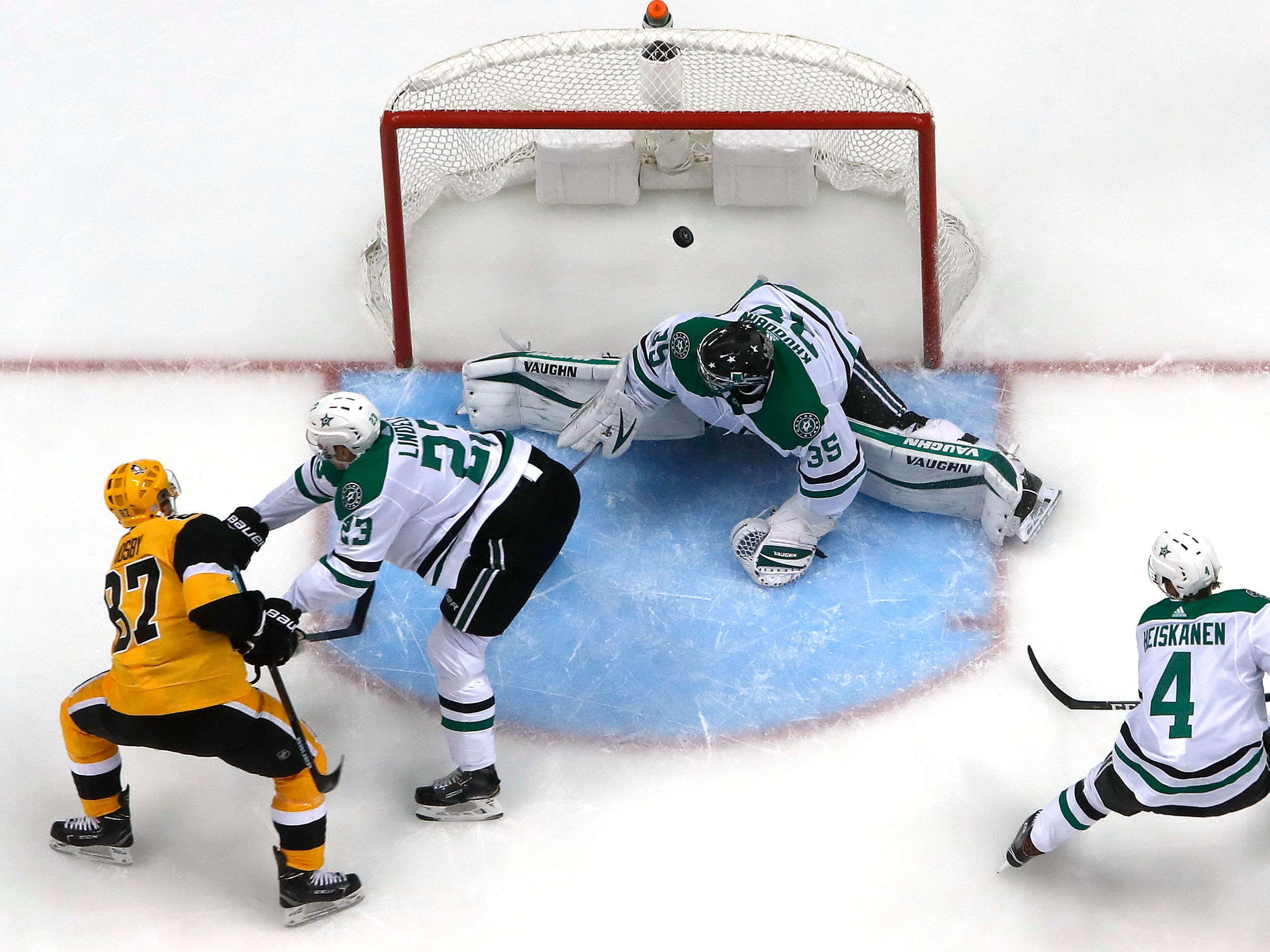 Nov. 21: Pittsburgh Penguins star Sidney Crosby, left, scores off a rebound against Dallas Stars goaltender Anton Khudobin. He took an in-tight backhander, kicked the rebound to his forehand and scored.