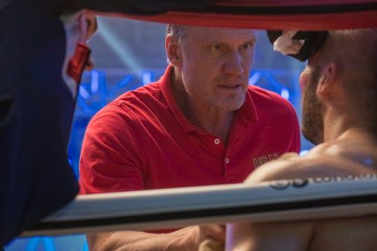 "Ivan Drago (Dolph Lundgren) talks intently to his son Viktor (Florian Munteanu) in ""Creed II."""