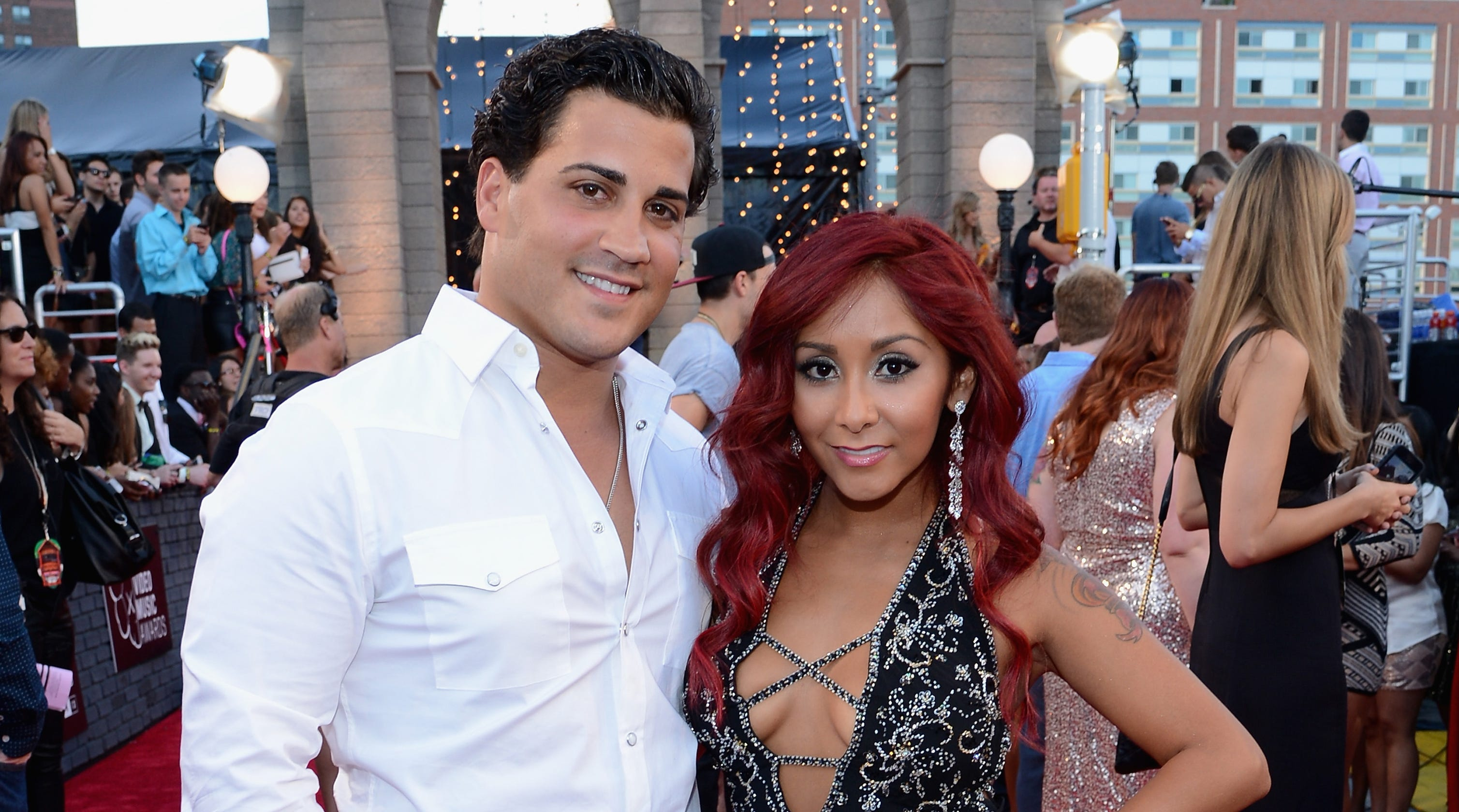 Nicole 'Snooki' Polizzi is 'miserable' she has to wait longer for baby No. 3 to arrive