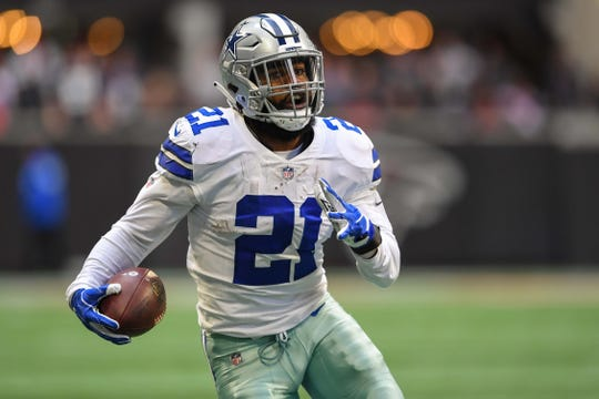 Dallas Cowboys running back Ezekiel Elliott (21) runs against the Atlanta Falcons during the first half at Mercedes-Benz Stadium.
