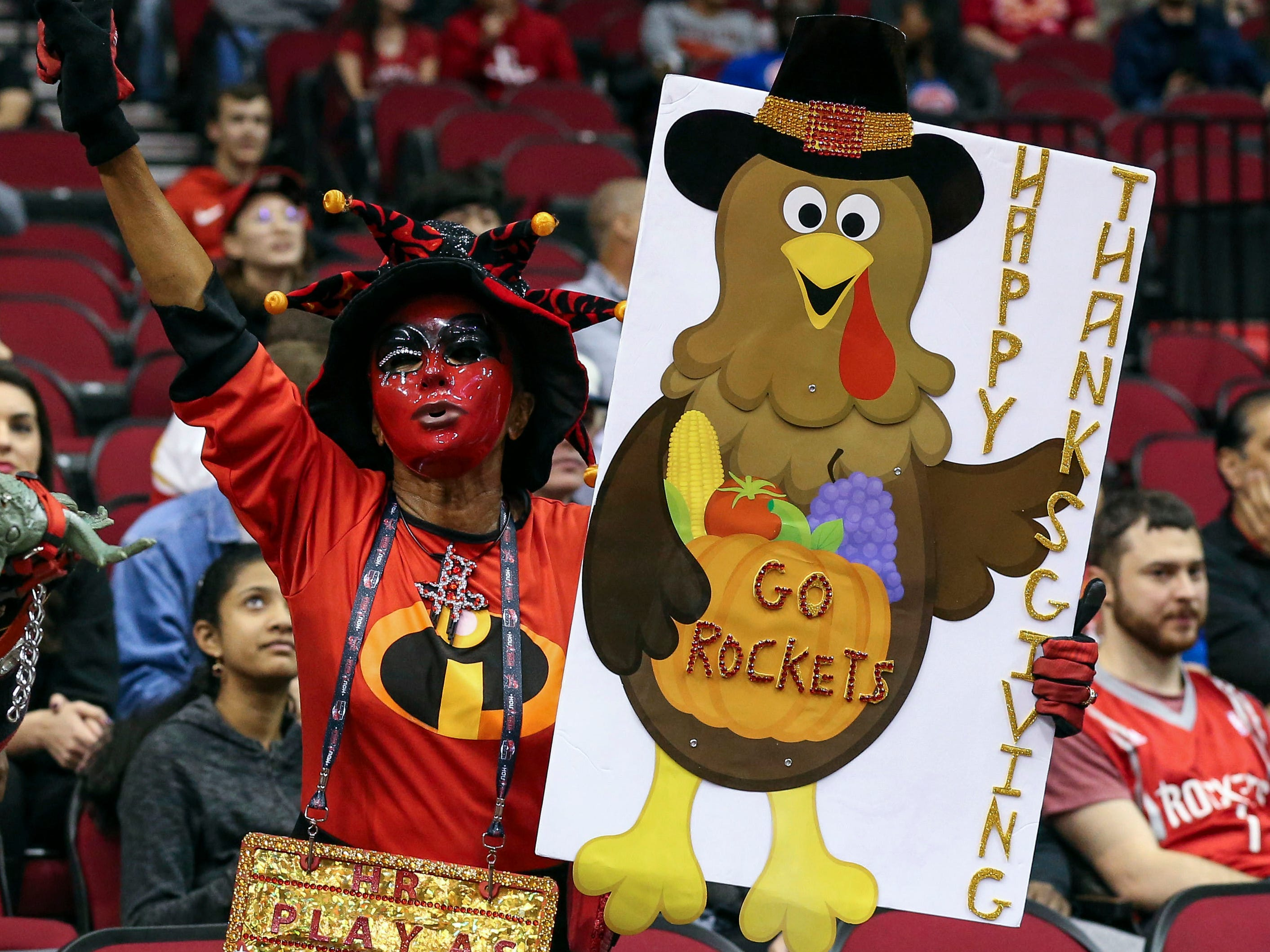 Nov. 21: A fan holds a Thanksgiving sign before a game between the Rockets and the Pistons at Toyota Center.