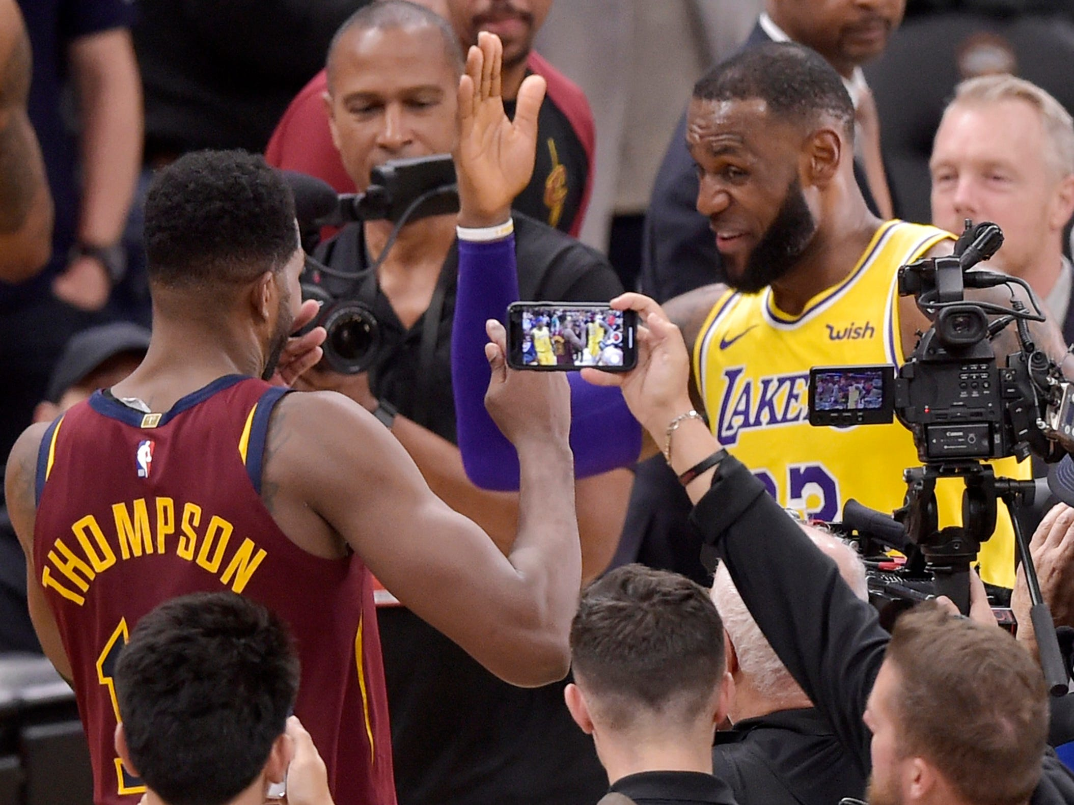 James greets former Cavaliers teammate Tristan Thompson after the game.