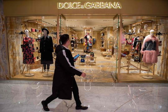 Dolce & Gabbana canceled a long-planned fashion show in Shanghai on November 21 after an outcry over racially offensive posts on its social media accounts, a setback for the company in the world's most important luxury market.