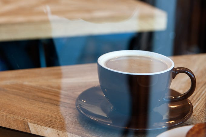 BROOKLYN, NY - FEBRUARY 22: A cup of coffee sits on a table at Colson Patisserie on February 22, 2016 in the Brooklyn borough of New York City. A recently released study found that drinking two cups of coffee a day decreases one's chance of developing liver cirrhosis by 44 percent.  (Photo by Bryan Thomas/Getty Images) ORIG FILE ID: 511709926