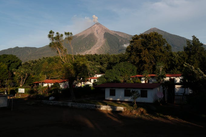 The Volcan de Fuego, or Volcano of Fire, spews a plume of ash as seen from San Juan Alotenango, Guatemala, Tuesday, Nov. 20, 2018. The volcanology institute reported that activity subsided Monday evening. Hundreds of families who heeded the call of disaster coordination authorities to evacuate 10 communities began returning to their homes Tuesday.