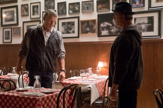 "It's been a while: Dolph Lundgren's Ivan Drago stares down Sylvester Stallone's Rocky Balboa in ""Creed II."""