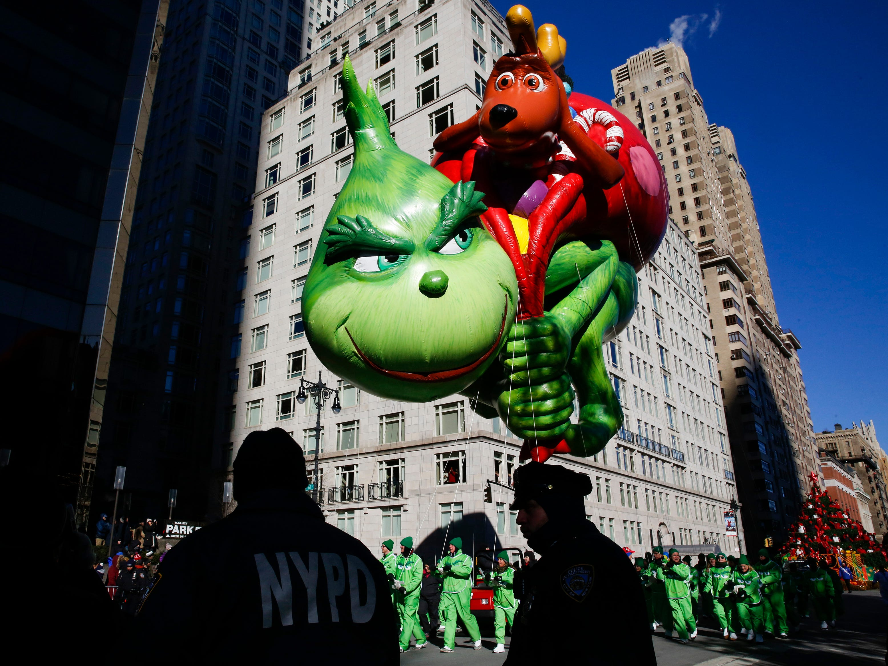 The Grinch balloon floats over Central Park West during the 92nd annual Macy's Thanksgiving Day Parade in New York, Thursday, Nov. 22, 2018.