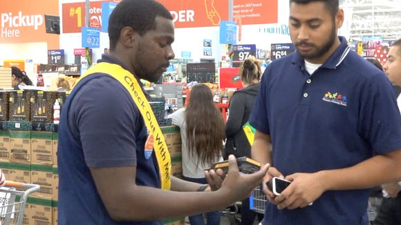 Walmart clerk Anthony Todd uses Check Out with Me app to process transaction