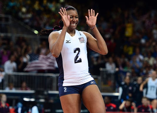U.S. Olympic volleyball star injured trying to save her sister