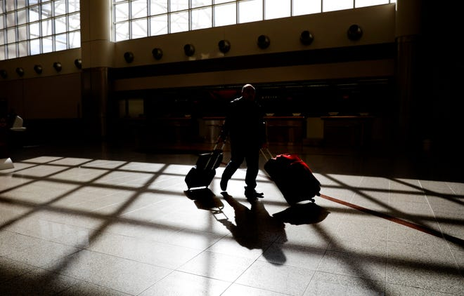 Travelers should have plenty of room at airports around Thanksgiving this years, as AAA expects airports travel to drop by about half. Overall, AAA says Thanksgiving travel should drop by at least 10%. (Associated Press file photo)