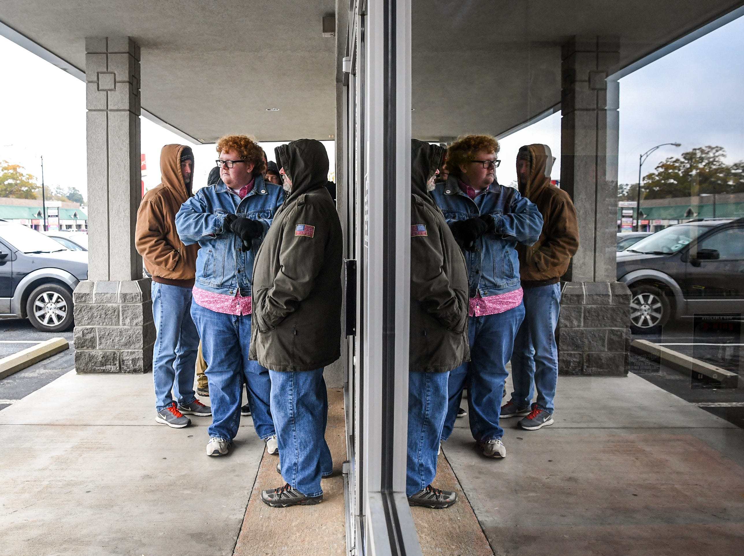 Coleman Grimes, left, and his father Robbie Grimes of Powdersville line up at Rainbow Records for Record Store Day on Black Friday in Anderson on Friday, November 23, 2018.