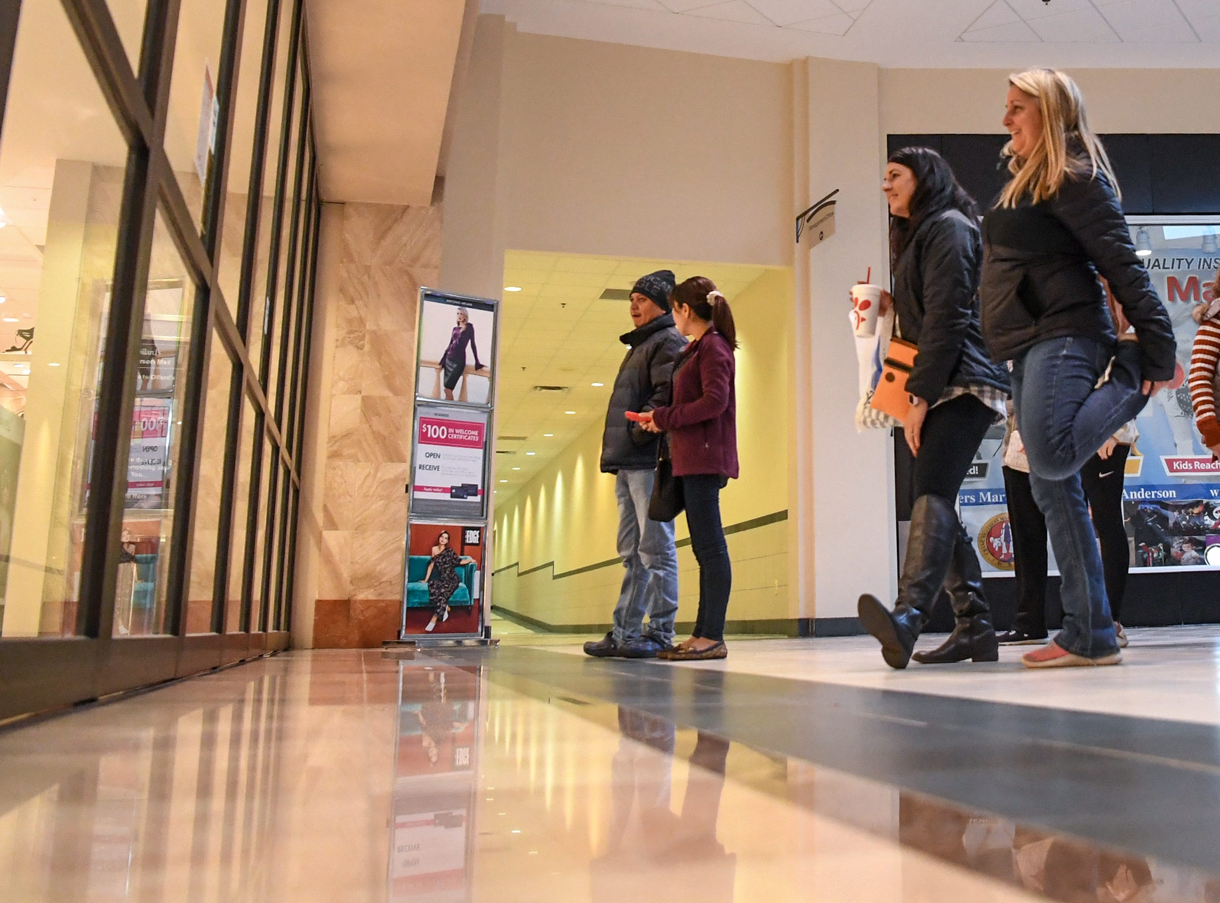 Jennifer Crosby, left, and Jennifer Hanvey get ready to go in Dillard's during Black Friday at the Anderson Mall in Anderson on Friday, November 23, 2018.